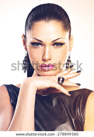 Beautiful fashion sexy woman with black nails at pretty face.  - stock photo
