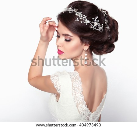 Beautiful fashion with brown curly hair styling and expensive pendant close-up. - stock photo