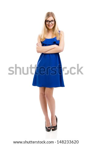 Beautiful fashion woman in blue dress using nerd glasses, isolated over white background - stock photo