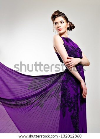 Beautiful fashion woman in violet long dress  hairstyle with pigtails design - stock photo