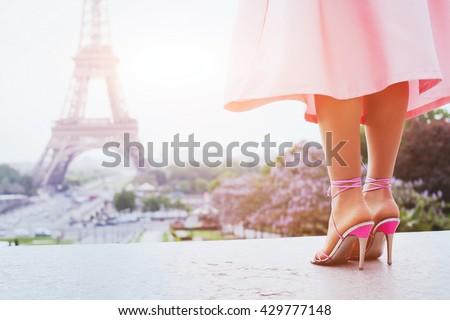 beautiful fashion woman on high heels near Eiffel tower in Paris, France - stock photo