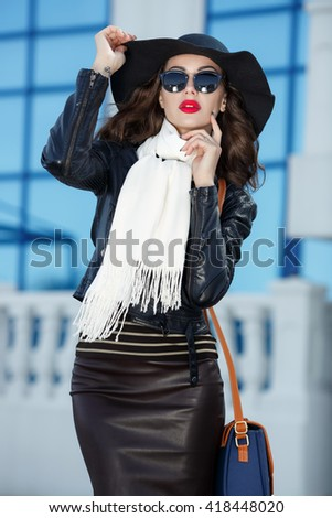 Beautiful fashion woman outdoors portrait, Fashionable girl model in black leather jacket series - stock photo