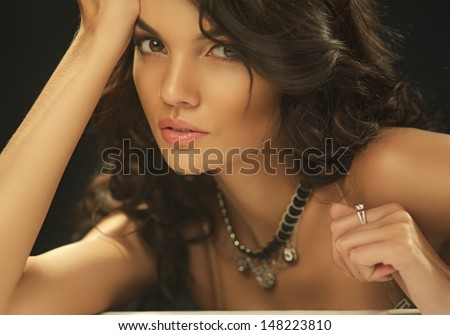 Beautiful fashionable Brunette Girl. Perfect Makeup. Make-up. Close-up Portrait - stock photo