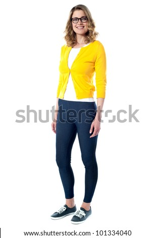 Beautiful fashionable glamour girl standing in front of camera - stock photo