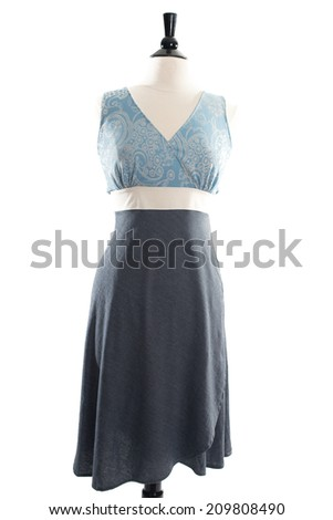 Beautiful, fashionable hand made dress, on mannequin, isolated on white background in studio