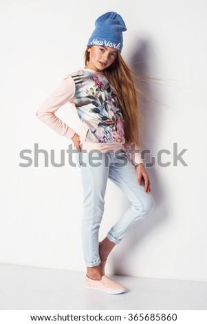 beautiful fashionable kid girl  isolated on white - stock photo