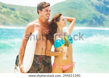 beautiful fashionable surf couple on a beach - stock photo
