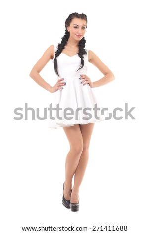 Beautiful fashionable woman in a white dress - stock photo