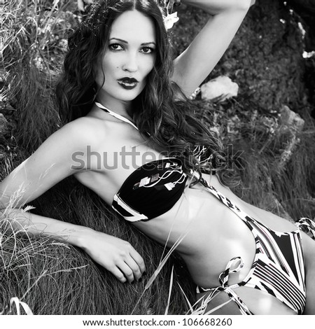 Beautiful fashionable woman in bikini outdoors - stock photo