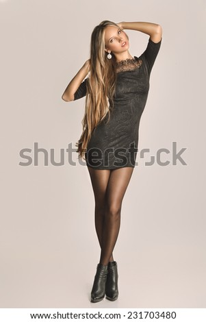 beautiful fashionable woman in black dress - stock photo