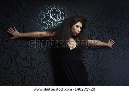 Beautiful fashionable woman in black dress. Studio shot.  - stock photo