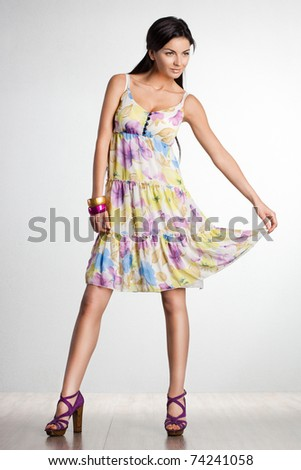 beautiful fashionable woman in dress - stock photo