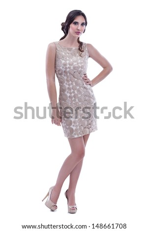 beautiful fashionable woman in dress, posing on white background