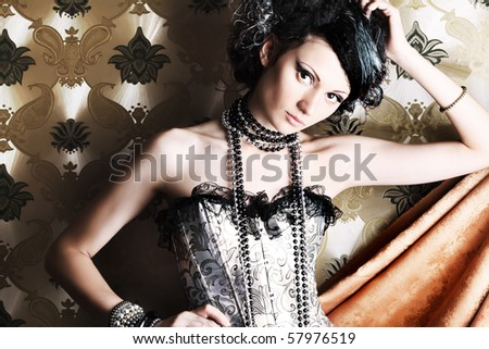 Beautiful fashionable woman over vintage background. - stock photo