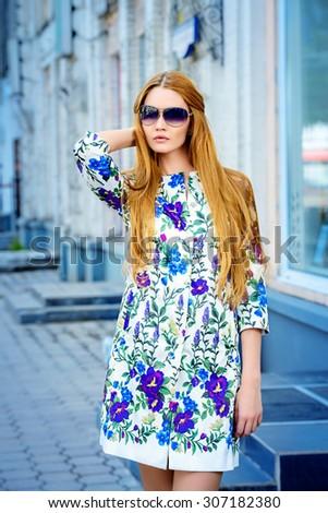 Beautiful fashionable woman walking on the city street. Elegant businesswoman outdoor.  - stock photo