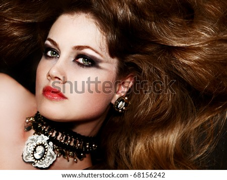 beautiful fashionable woman with fashionable hairstyle