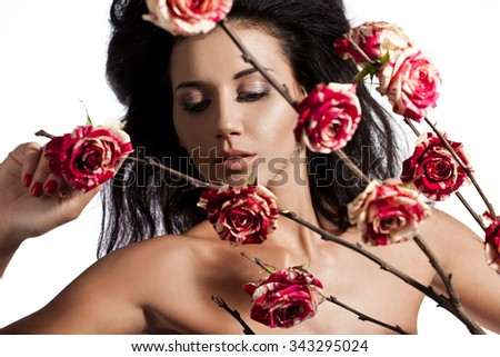 beautiful fashionable woman with roses - stock photo