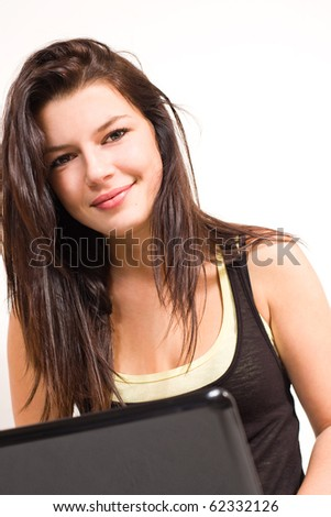Beautiful fashionable young brunette using laptop.