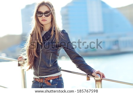 Beautiful fashionable young woman in sunglasses - stock photo