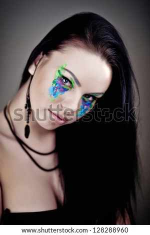 beautiful fashionable young woman with creative art make up in studio - stock photo