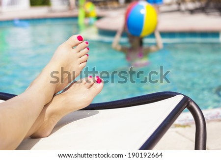 Beautiful Feet and toes by the swimming pool - stock photo