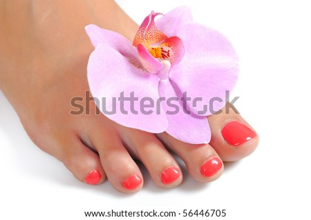 Beautiful feet leg with perfect spa pedicure on bright pink nails. white background - stock photo