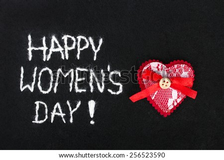 beautiful felt background for women's day with red heart - stock photo