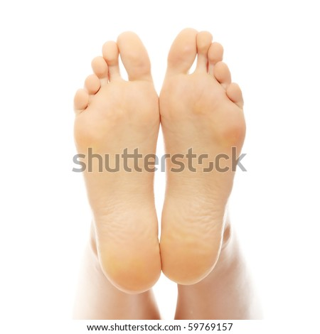 Beautiful female a foot and a heel lifted upwards on a white background - stock photo