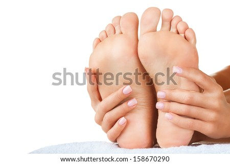 Beautiful female a foot and a heel on a white background - stock photo