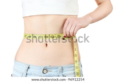 beautiful female abdomen and measuring tape isolated on white