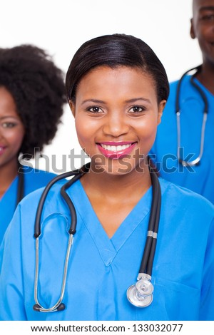 beautiful female african american nurse with colleagues  on background