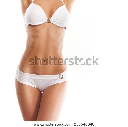 Beautiful female body in a swimsuit isolated on white - stock photo