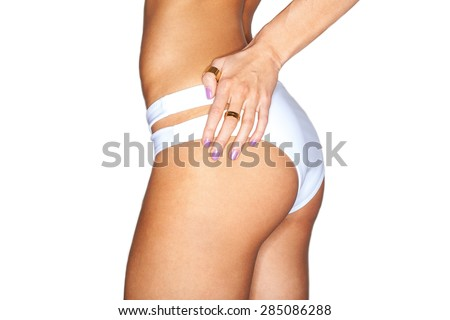 Beautiful female body. sexy ass in white swimming pants. isolated on white background - stock photo