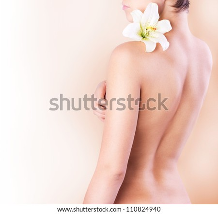 beautiful female body with flower - stock photo