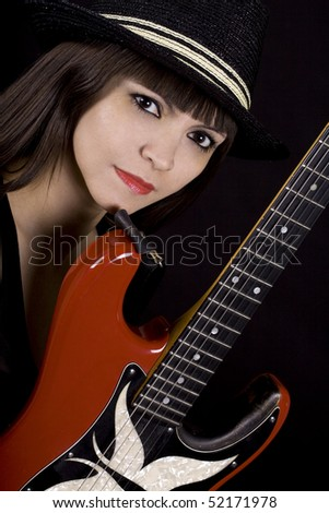 Beautiful female country singer holding guitar