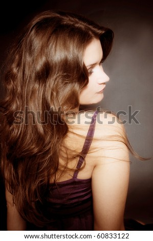 Beautiful female curly long hairs - back view - stock photo