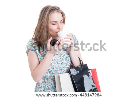 Beautiful female customer enjoying a fresh coffee and doing shopping isolated on white with copyspace area - stock photo