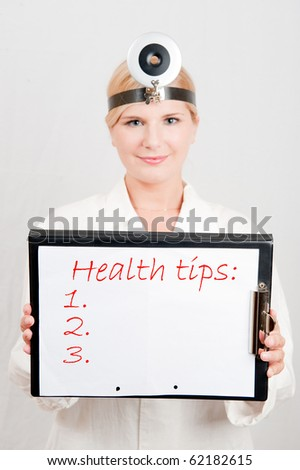 Beautiful female doctor giving health tips - blank place for your text - stock photo