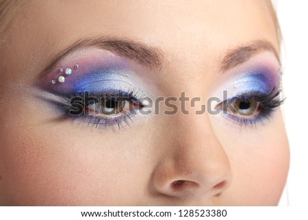 Beautiful female eyes with bright blue make-up