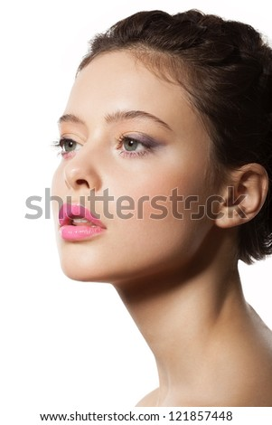 beautiful female face in profile with Makeup and Hairstyle - stock photo