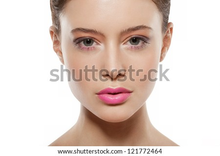 beautiful female face with makeup. serious girl looking at camera - stock photo