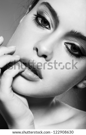 beautiful female face with natural makeup, black and white - stock photo