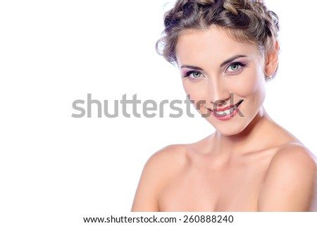 Beautiful female face with pure skin and natural make-up. Spa girl. Skincare, healthcare. Isolated over white background. Copy space. - stock photo