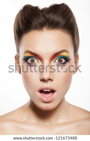 beautiful female face with rainbow makeup. bewildered girl - stock photo