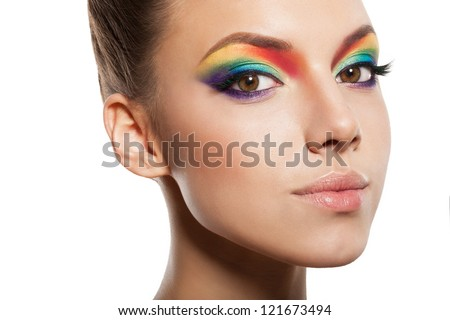 beautiful female face with rainbow makeup. girl looking at camera - stock photo