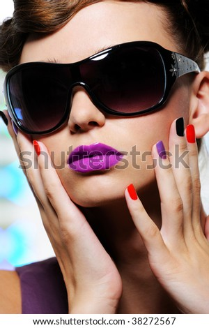 beautiful female face with stylish sunglasses - close-up portrait