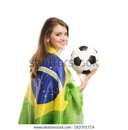 Beautiful female fan with brazilian flag holding a soccer ball isolated on white background - stock photo