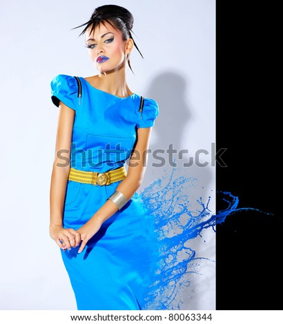 Beautiful female fashion model with paint splash - stock photo