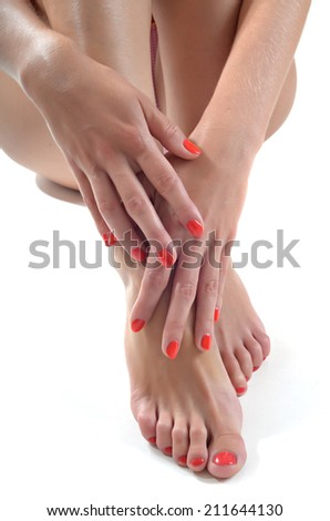 beautiful female feet at spa salon on pedicure procedure - stock photo