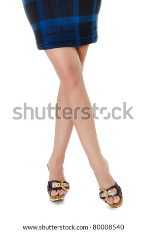 Beautiful female feet in shoes isolated background